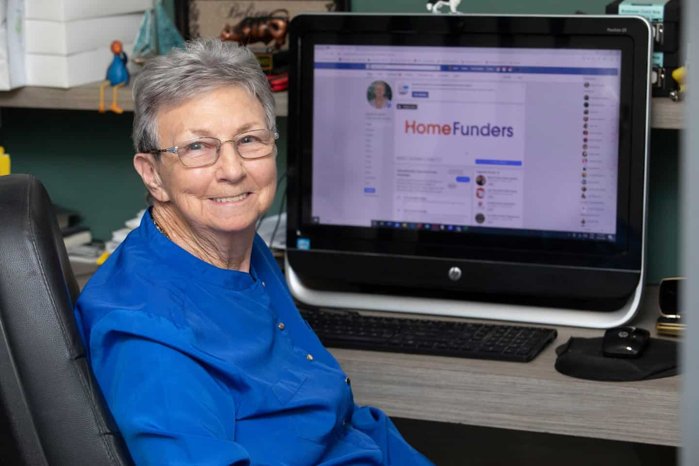 image of Gayle Copeland, owner of Home Funders Australia, at her desk working