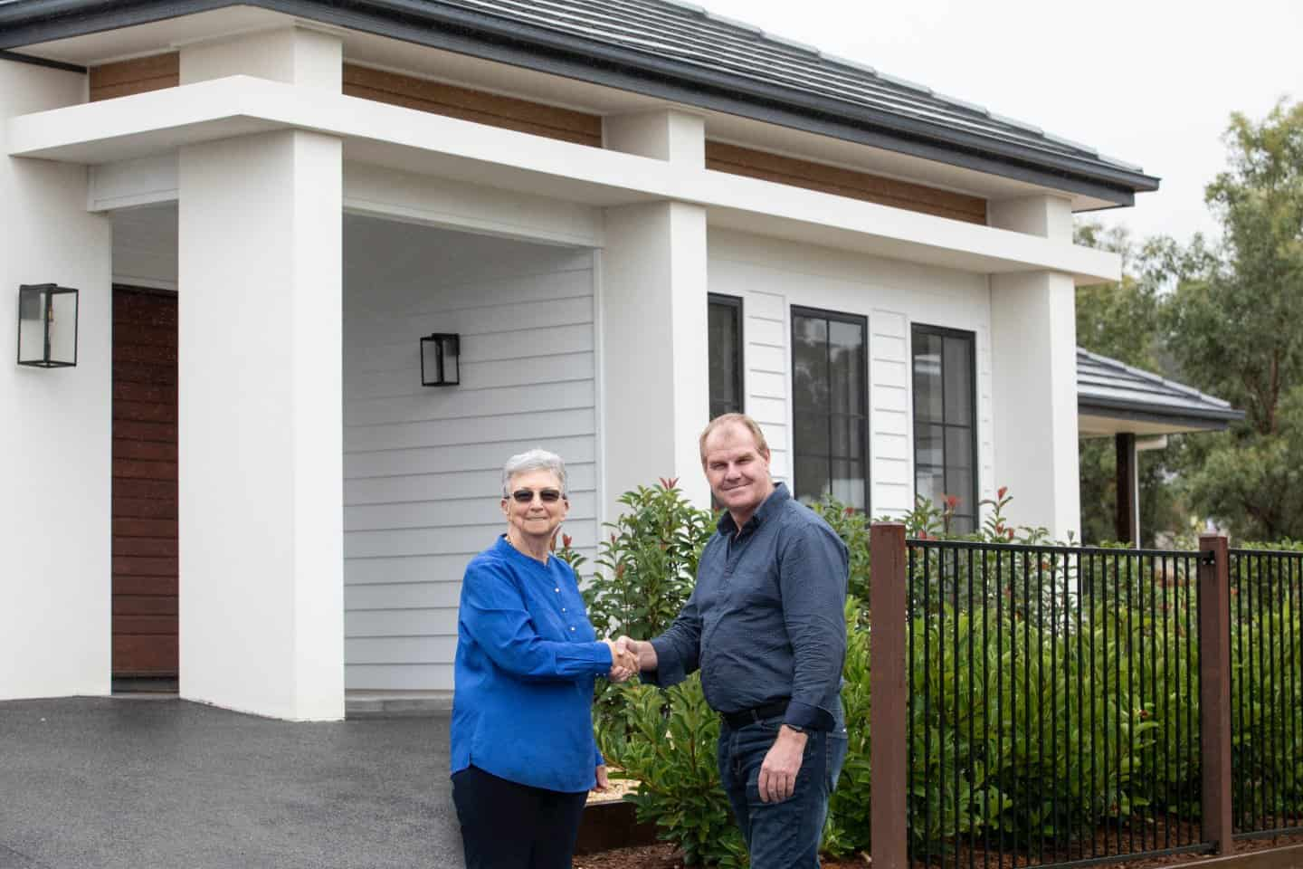 image of Gayle Copeland, owner of Home Funders Australia, shaking hands with a happy client
